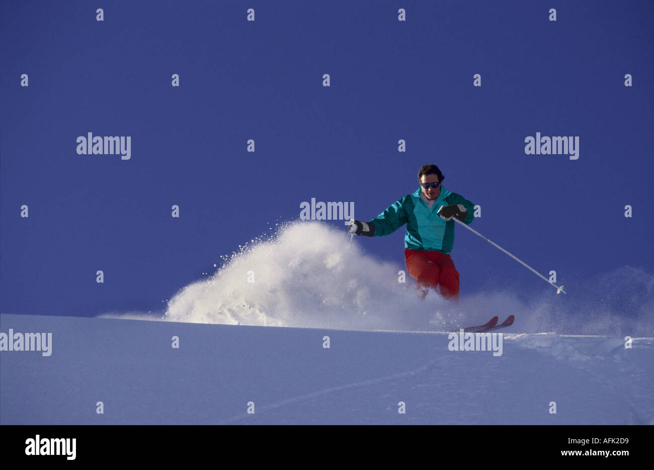 Archive photo (Circa 1984). A skier skis powder snow in The 3 Valleys area at the resort of Courchevel 1850, Savoie, France.. - Stock Image