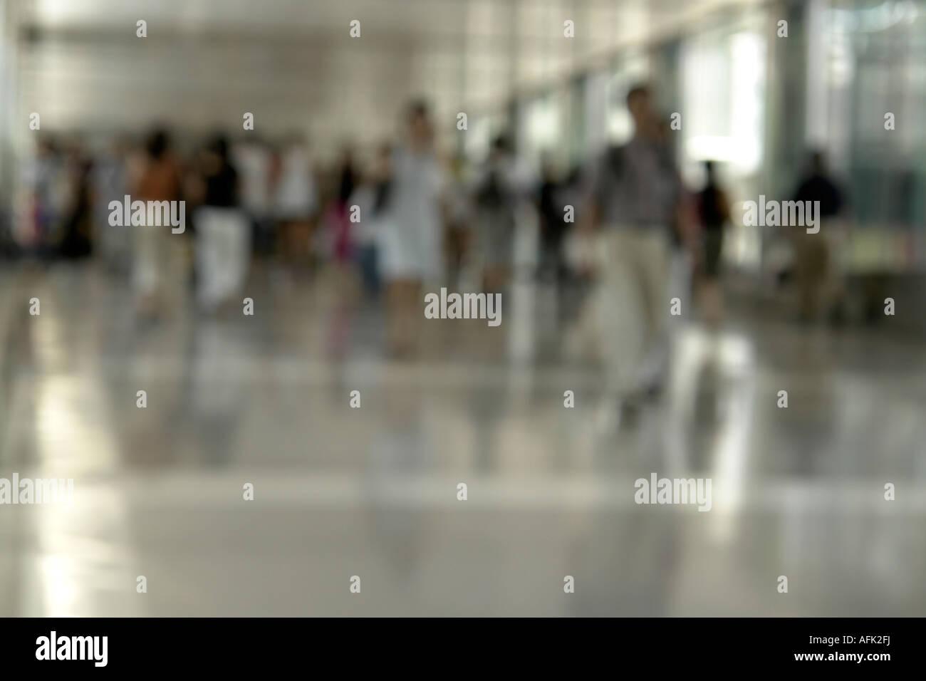 Pedestrians walking in shopping arcade Hong Kong China - Stock Image