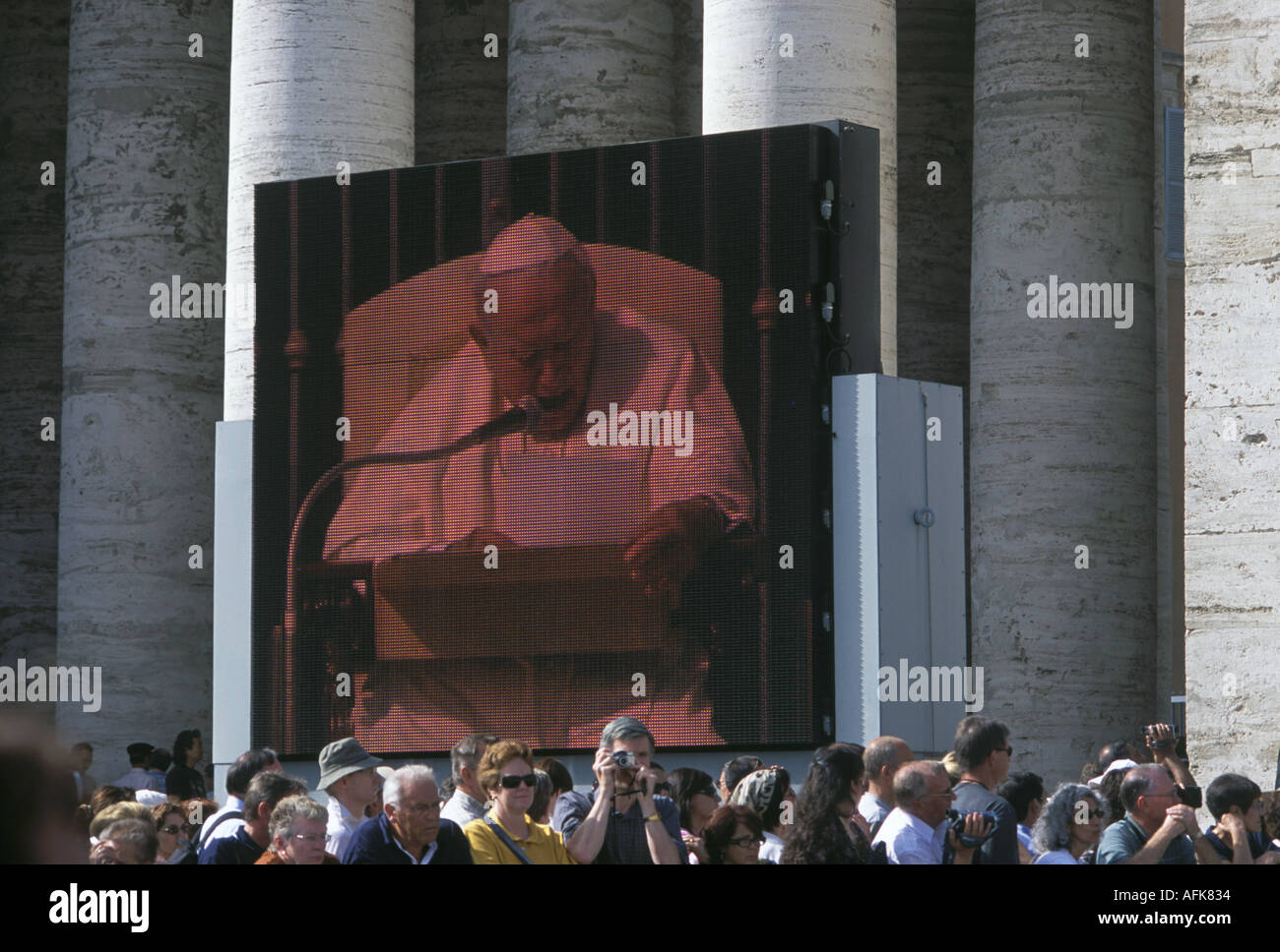 An 84 year old Pope John Paul II shown on the big screen as he celebrates mass in Saint Peter s Square in Rome s Stock Photo