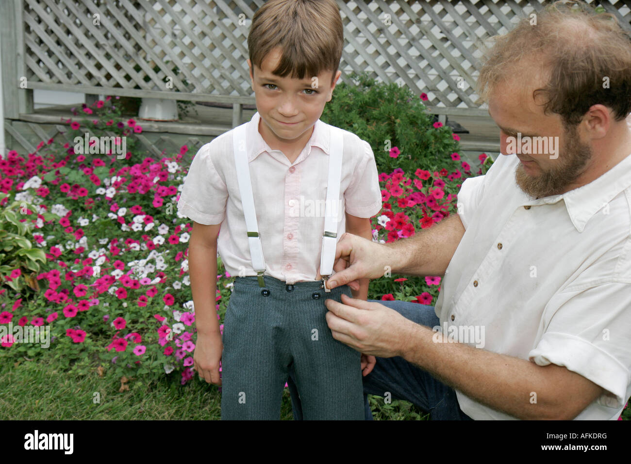 Indiana Shipshewana Amish Farm Tour boy suspenders father