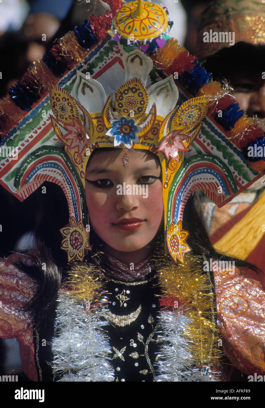 FACE OF WOMAN IN TRADITIONAL DRESS IN KATHMANDHU NEPAL 1986 PHOTO BY TERRY FINCHER - Stock Image
