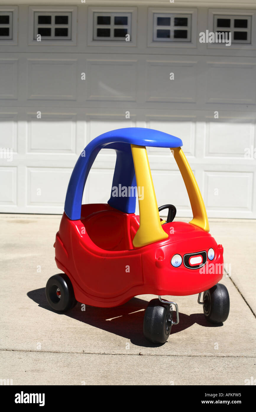 Plastic Toy Car in Driveway - Stock Image