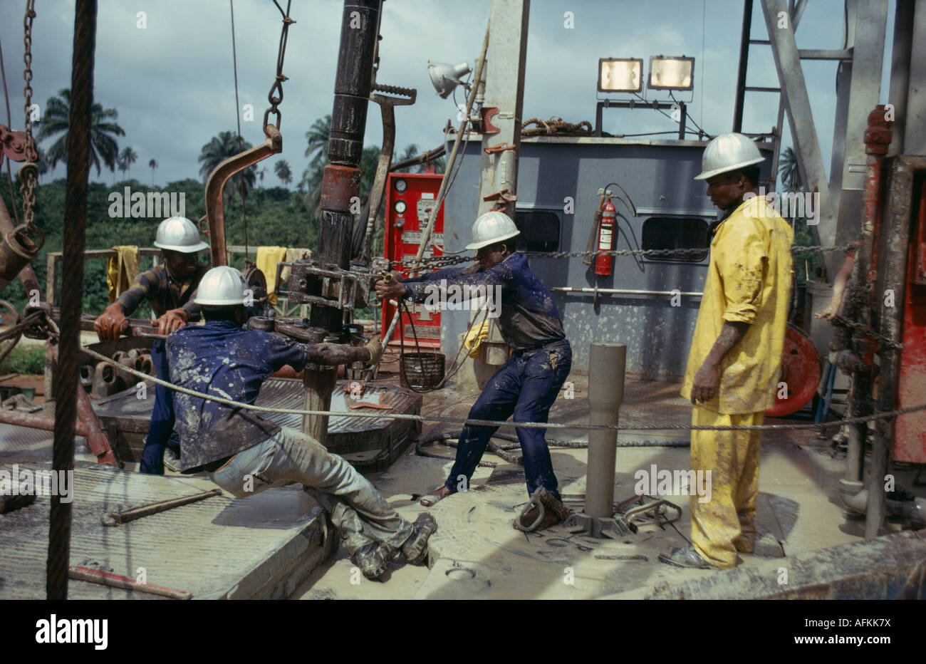 NIGERIA West Africa Rivers State Bonny Industry Male workers on off-shore oil rig platfrom - Stock Image