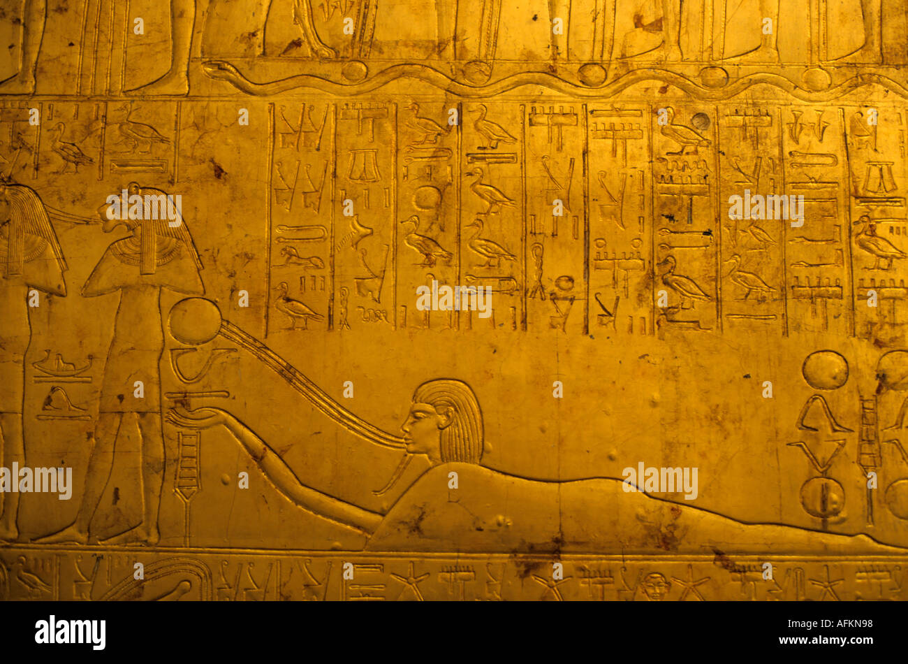 Hieroglyphics on Tutankhamun's gold tomb at the Egyptian Museum in Cairo, Egypt. - Stock Image