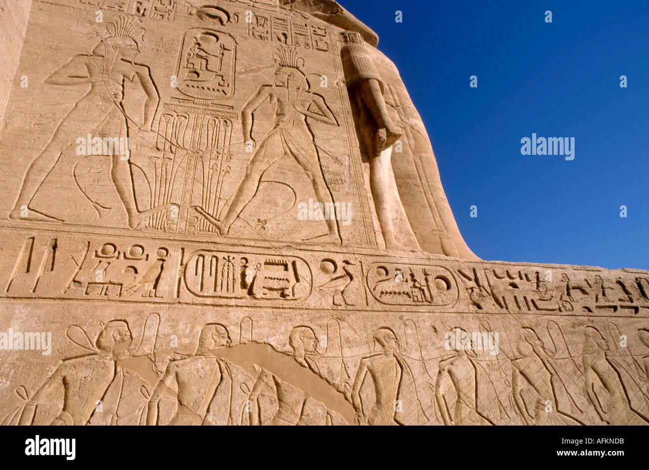 Egypt Abu Simbel - Bas-relief hieroglyphics on the Ramses 2 / ii Temple - Stock Image