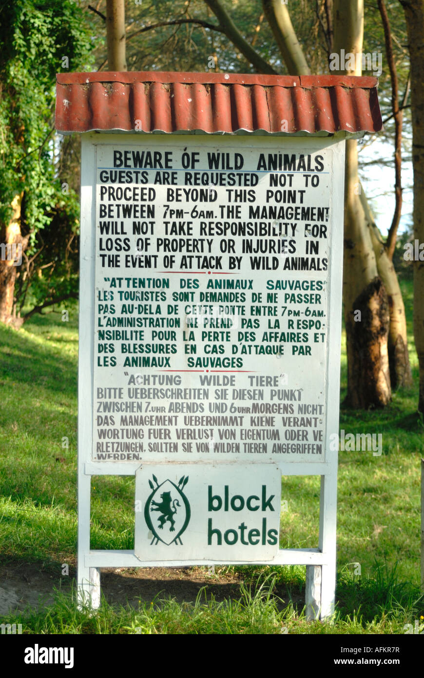 Sign warning of the danger of wild animals in the grounds of Lake Naivasha Club Kenya East Africa Stock Photo