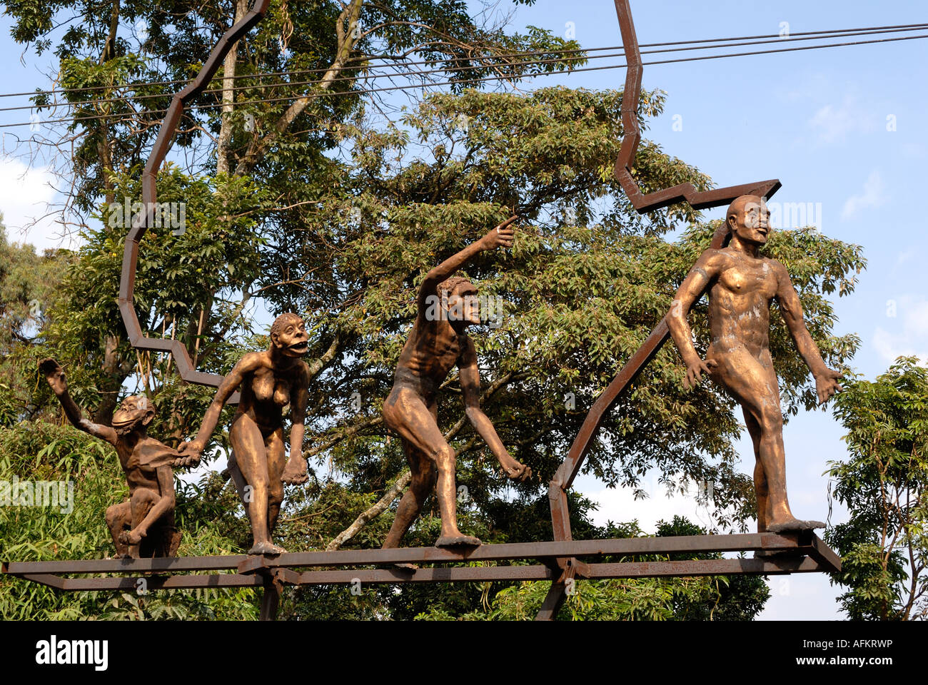 A bronze statue showing the evolution of man outside the National Museum Nairobi Kenya East Africa - Stock Image