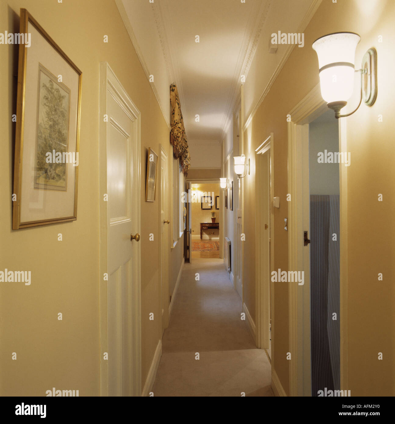 Lighted wall lights in hotel corridor Stock Photo: 7985711 - Alamy