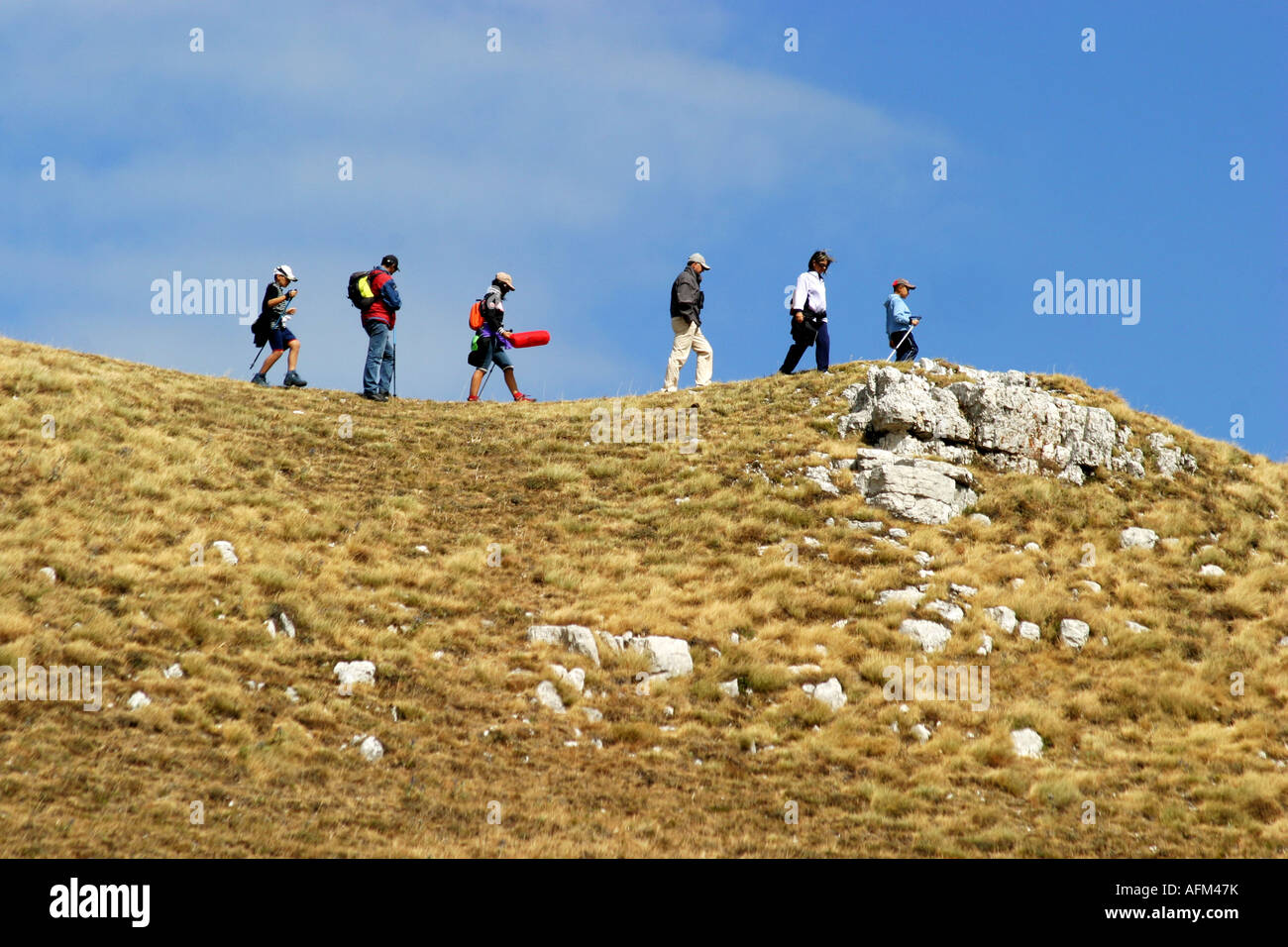 Hikers enjoy the Glorious colour of Sasso Tetto  mountain in the Sibillini National Park,Le Marche,the Marches, Stock Photo