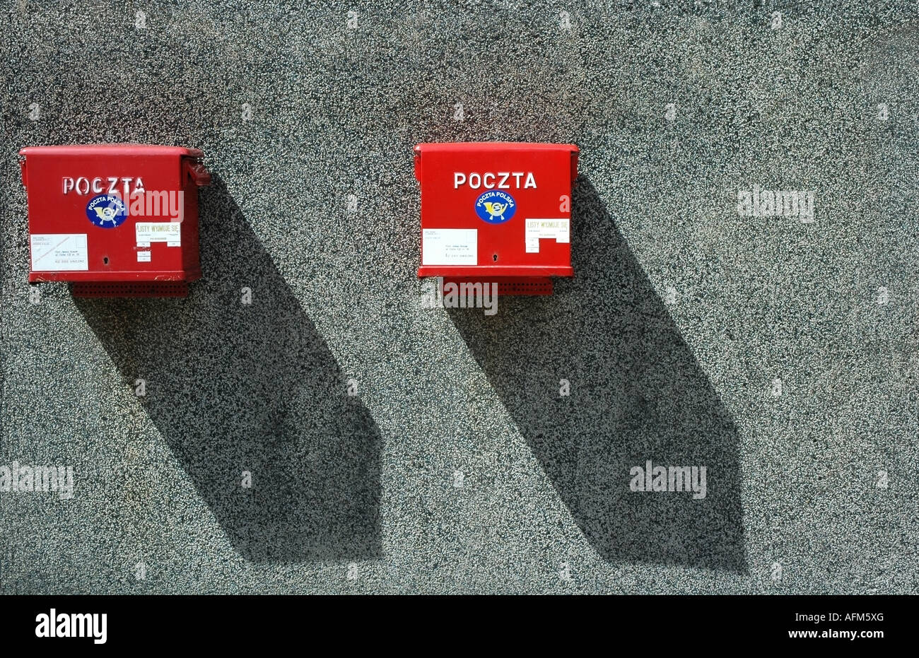 Two red letter postal box s, one old and one new on a gray wall, Warsaw, Poland, Europe, EU - Stock Image