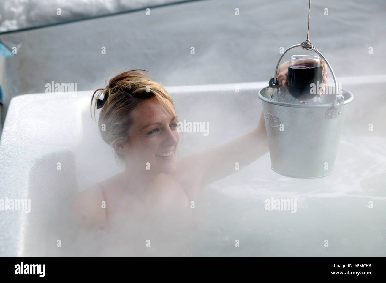 Girl snowboarders in a sauna steam bath after a heavy day on the ...