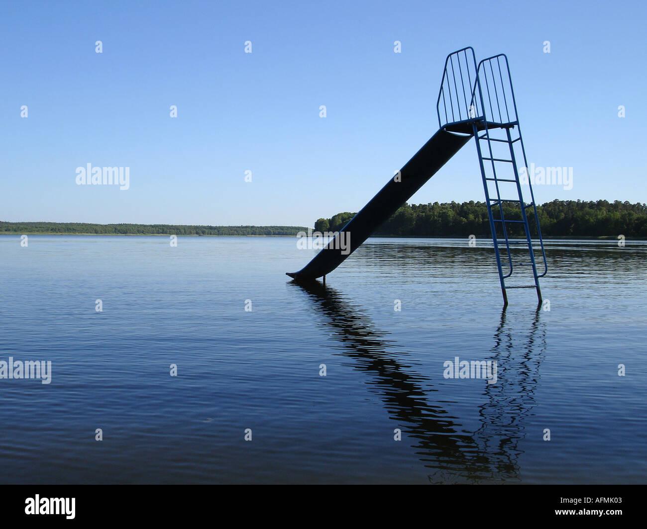 playground slide in water Rutsche im Wasser Stock Photo