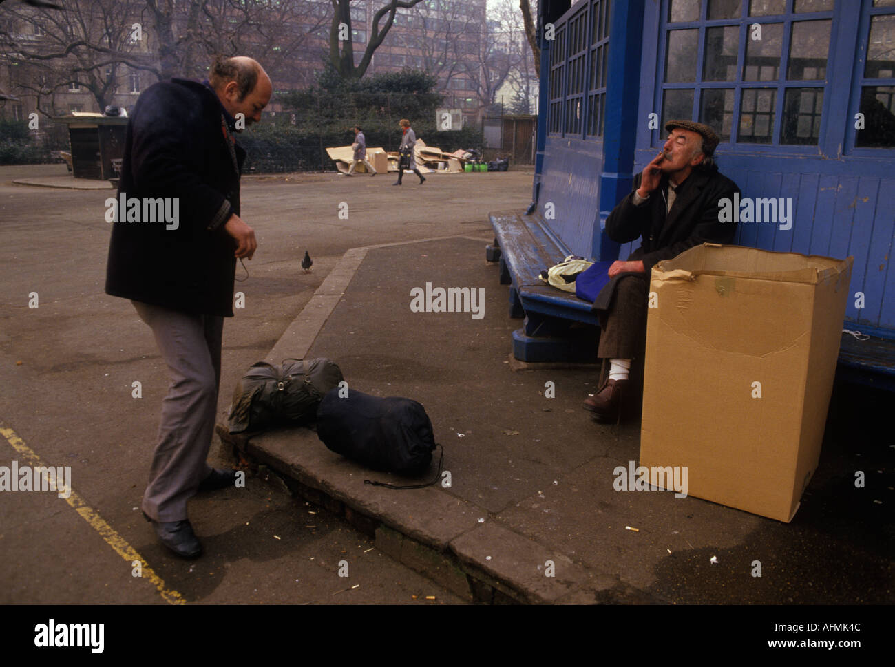 Tramps  sleeping rough chatting to each other central  London 1985 Lincoln Inns Field 1980s HOMER SYKES Stock Photo