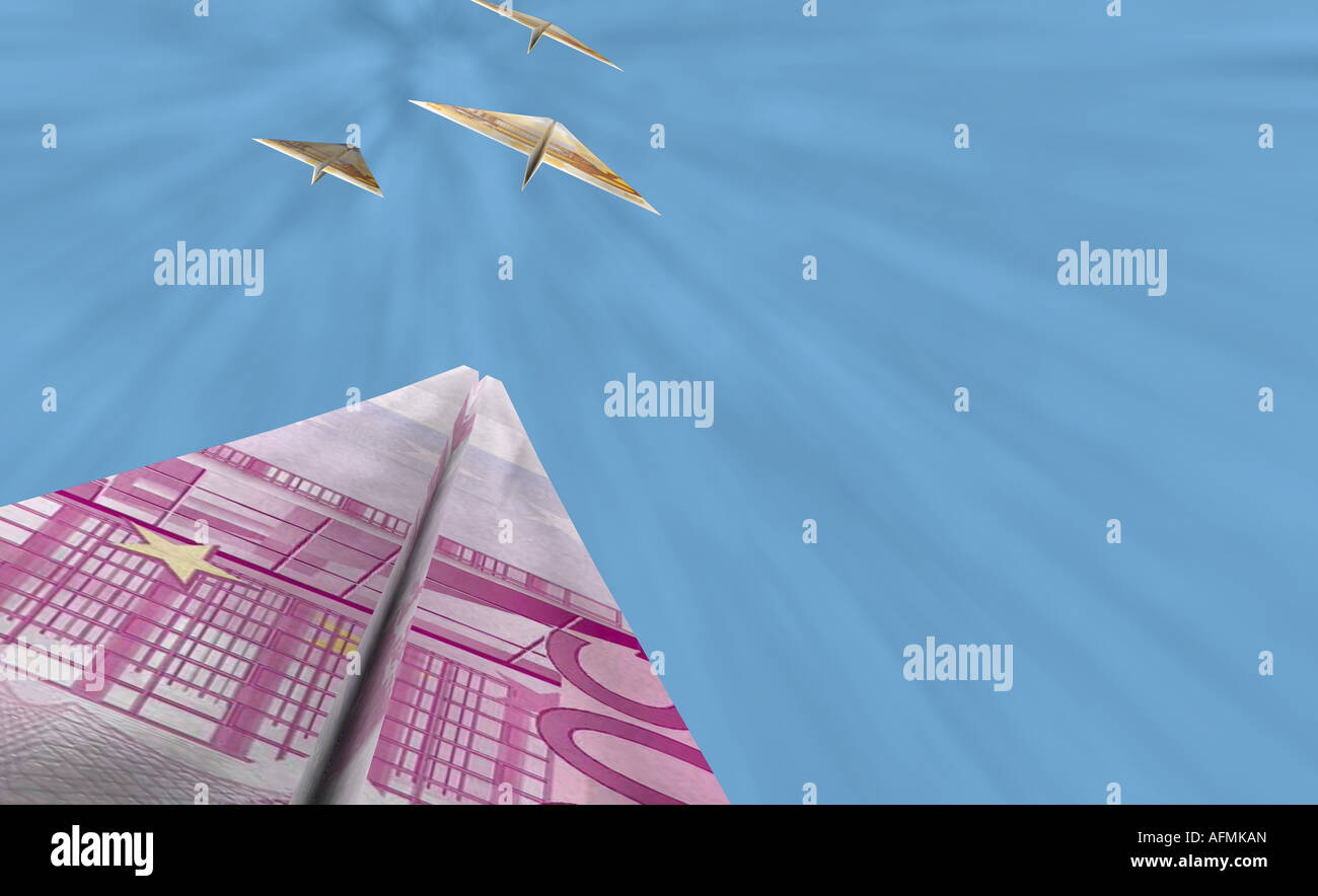 Bank notes in the shape of airplanes flying in the sky Stock Photo