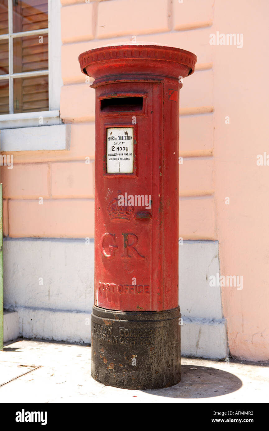 Red pillar box outside Vendue House, Bay Street, Nassau, New Providence, Bahamas. - Stock Image