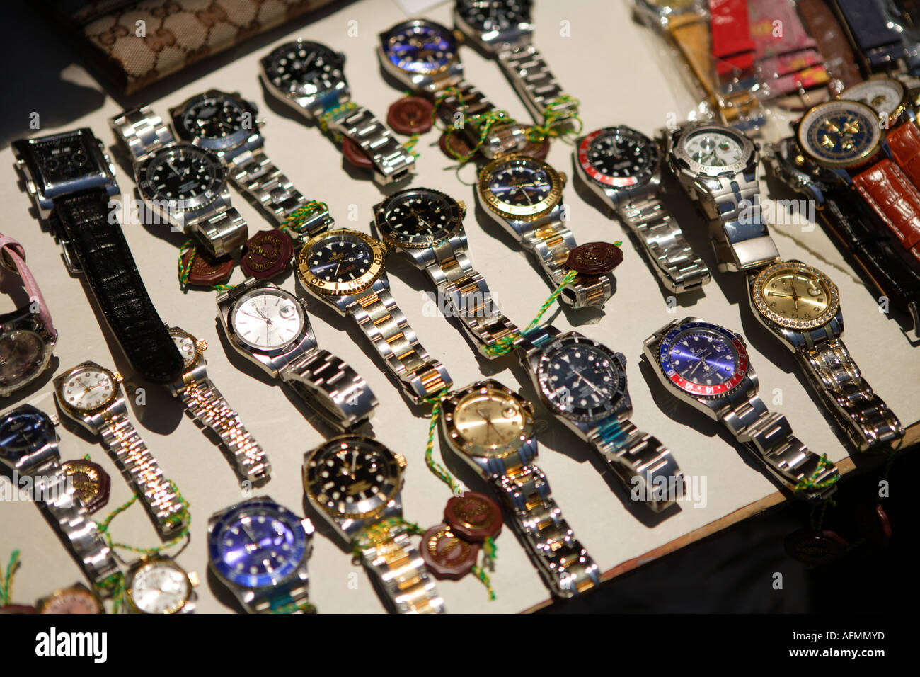 Fake Rolex watches for sale at the Straw Market, Downtown