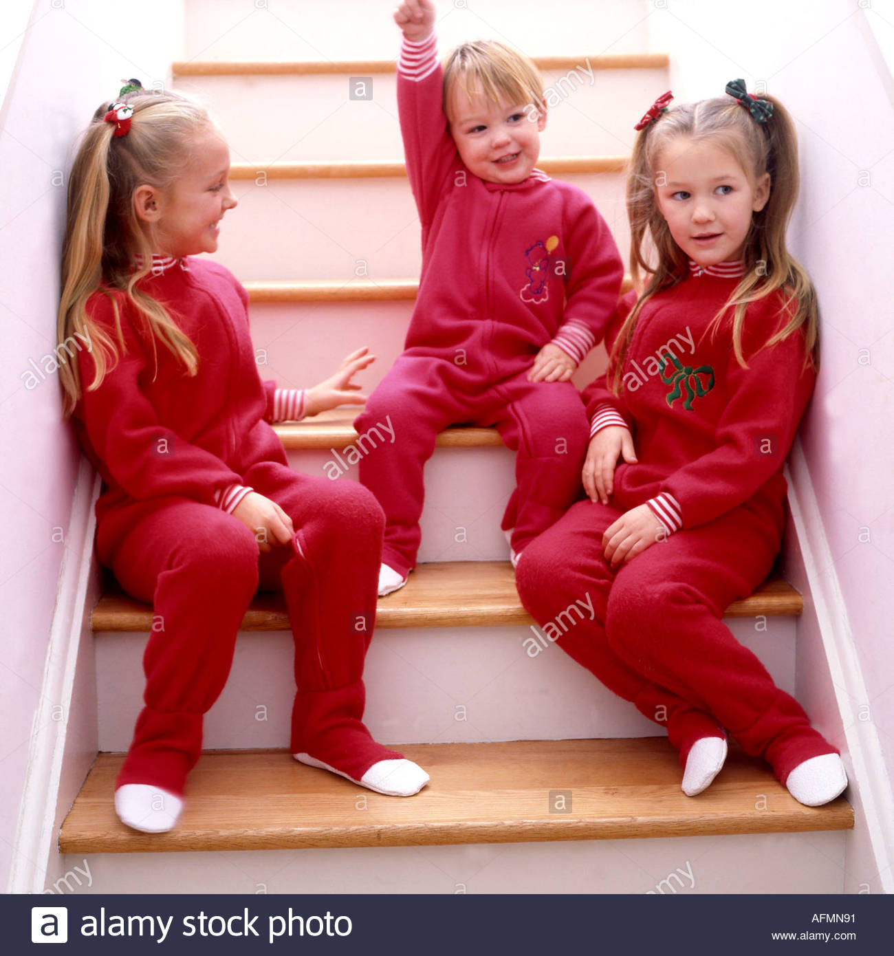 three children waiting for Christmas - Stock Image