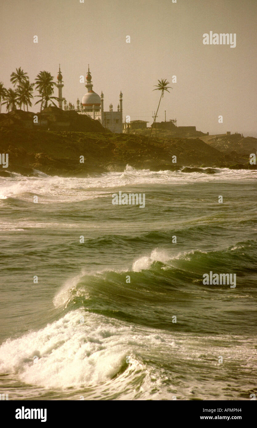 India Kerala Kovalam Vizhinjam mosque across heavy monsoon sea - Stock Image
