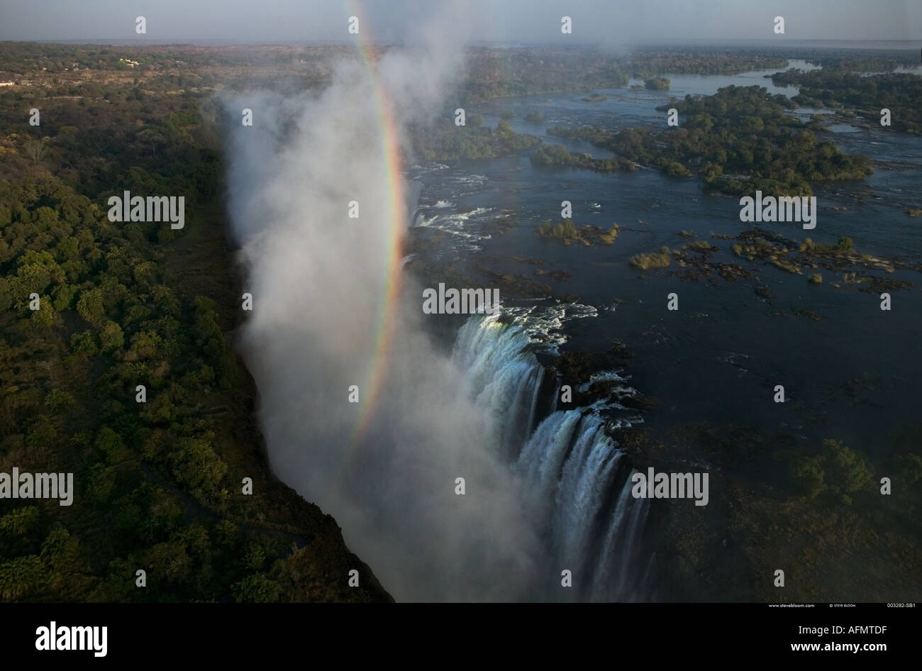 Rainbow over Victoria Falls Zimbabwe - Stock Image