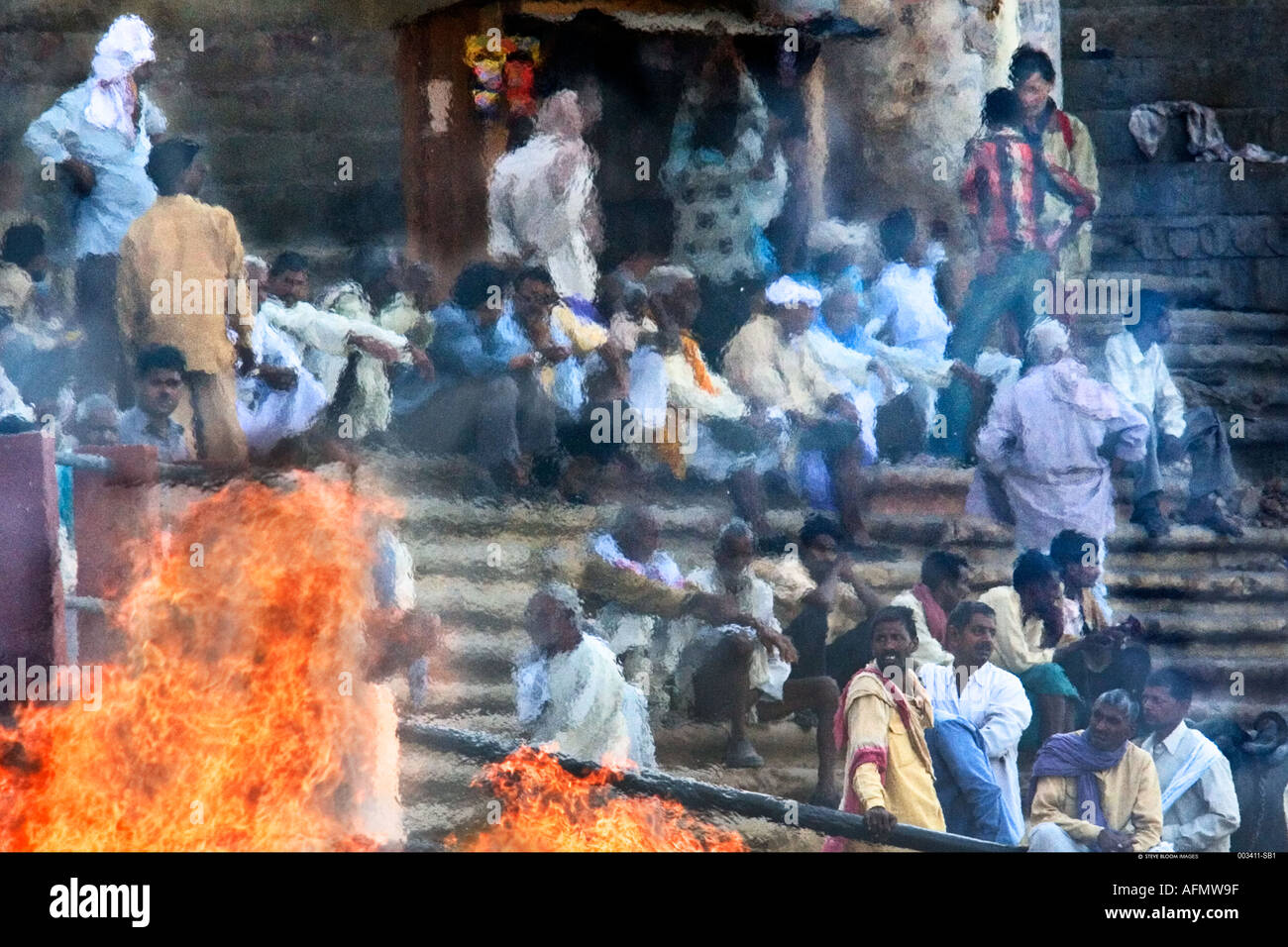 Crowds at a funeral pyre on the banks of the Ganges Varanasi India - Stock Image