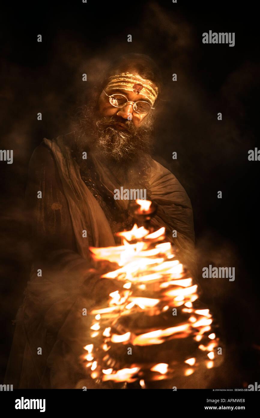 Hindu holy man performing religious ceremony puja Varanasi India - Stock Image