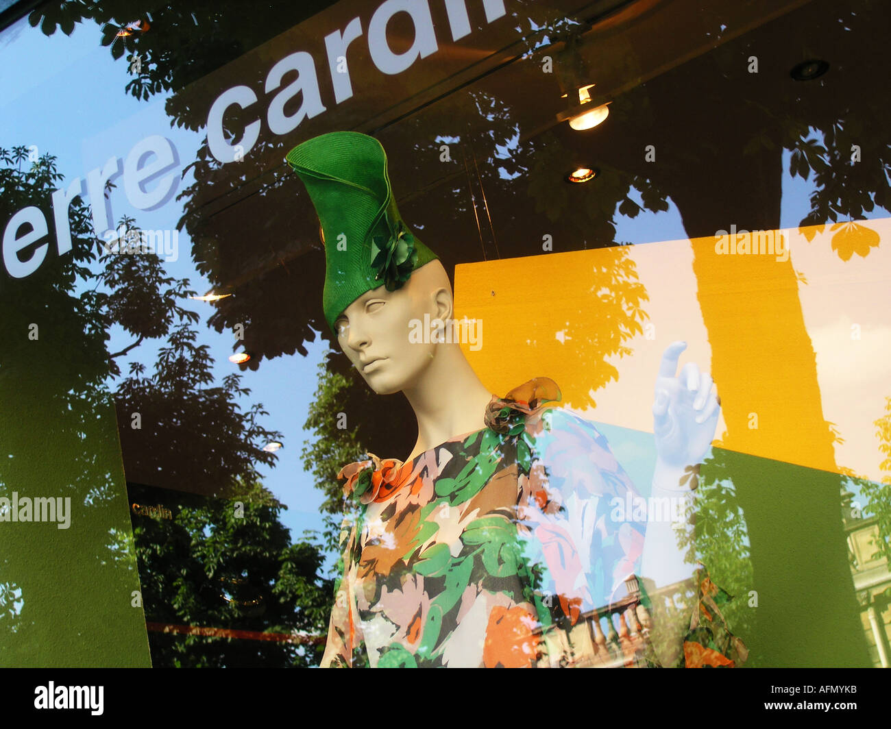 Shop window display with mannequin and reflection of trees at Pierre Cardin Paris France - Stock Image