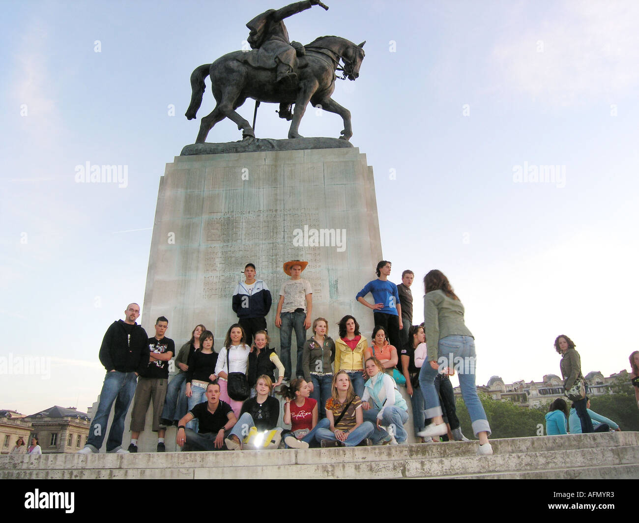 School group of adolescent students posing in front of statue de Joffre near Ecole Militaire Paris France - Stock Image