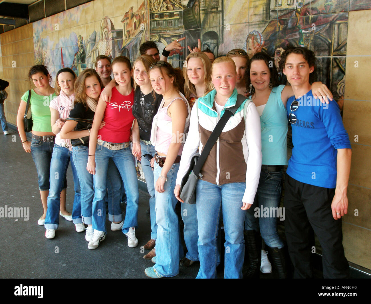 Group of students posing for the camera at Paris Bastille tube station Paris France - Stock Image