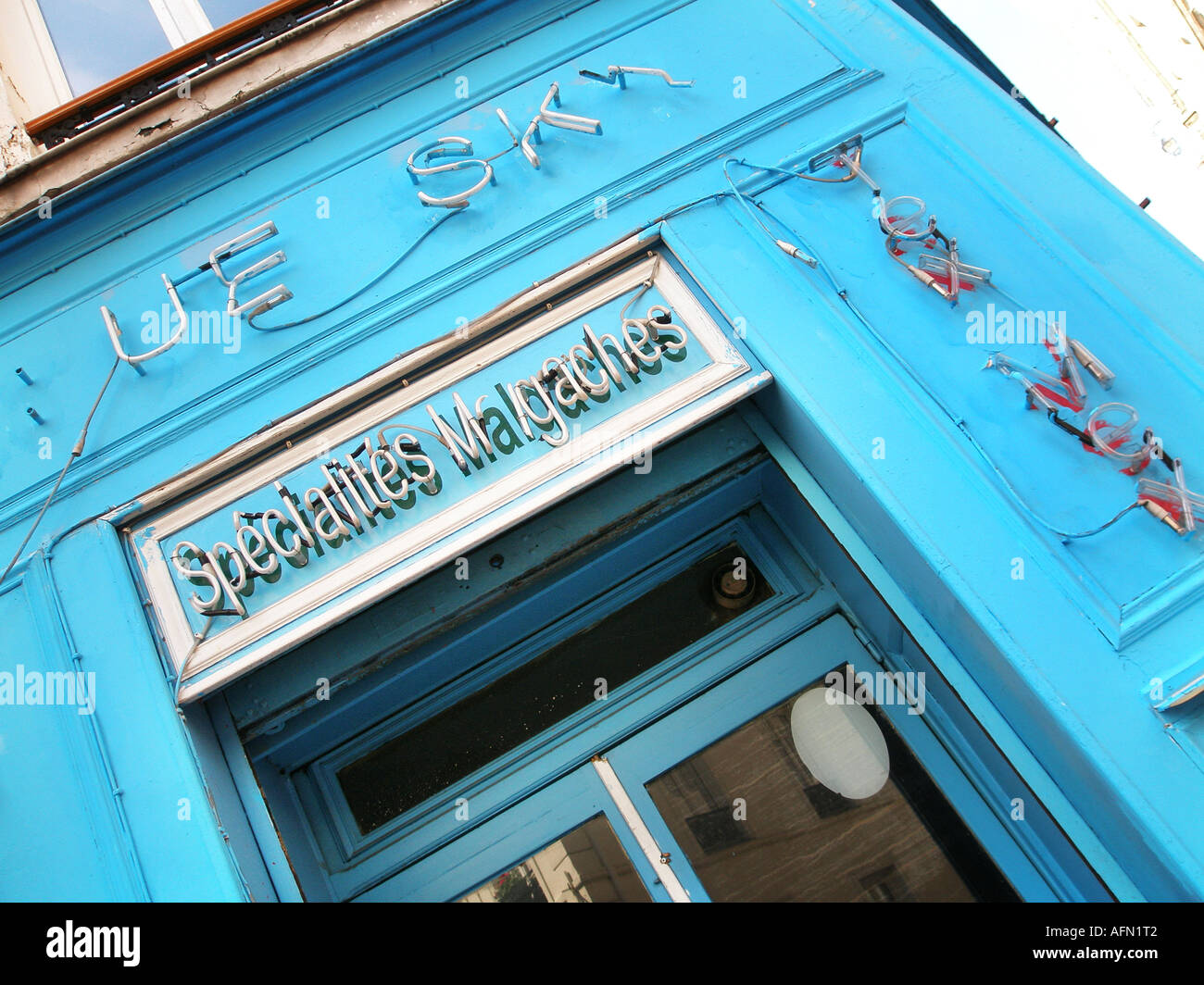 Desolate blue painted shop front of small shop in Montmartre Paris France - Stock Image