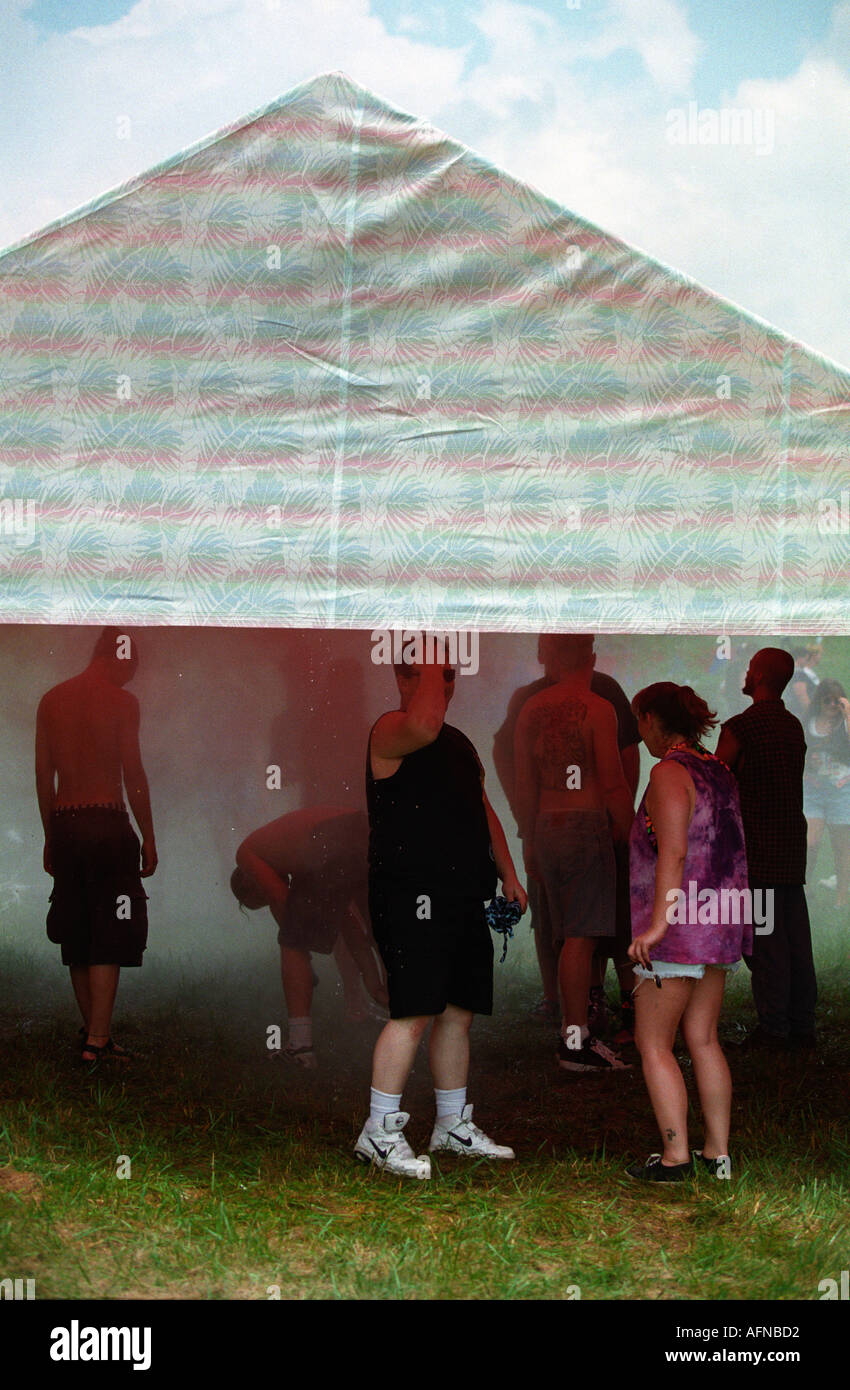 Lollapalooza concert goers standing in a mist room summer cool cooling, - Stock Image