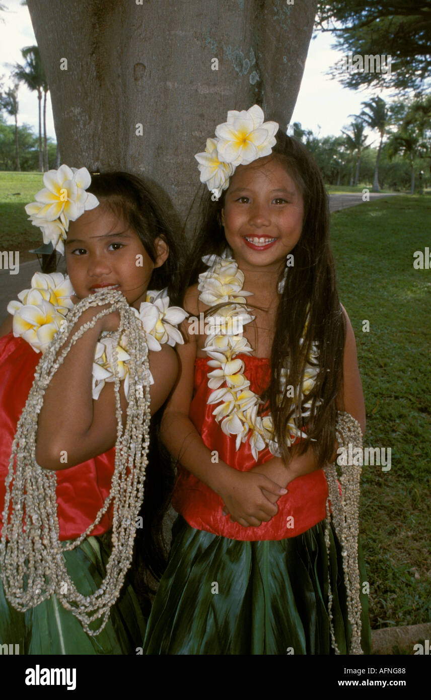 Hawaiian girls stock photos hawaiian girls stock images alamy smiling hawaiian girls with flowers in their hair greets visitors at the prince hotel in maui izmirmasajfo