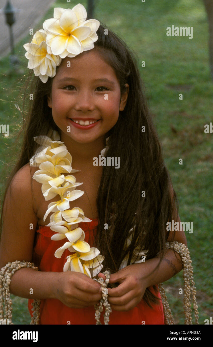 Smiling hawaiian girl flowers in stock photos smiling hawaiian a smiling hawaiian girl with flowers in her hair greets visitors at the prince hotel in izmirmasajfo