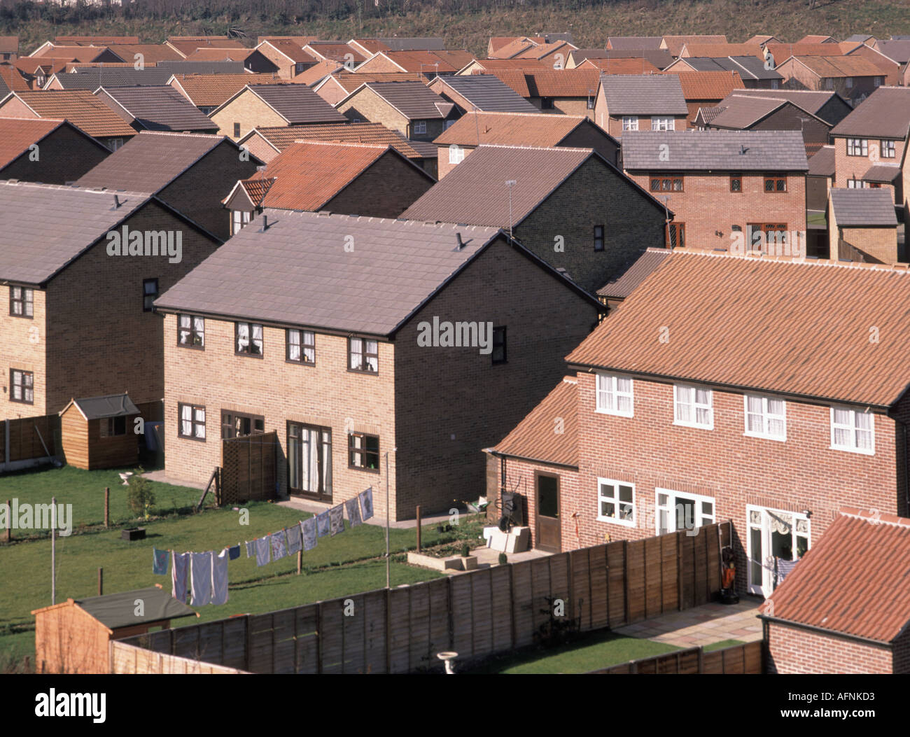Essex housing estate built early 1990s without conventional chimney flues - Stock Image