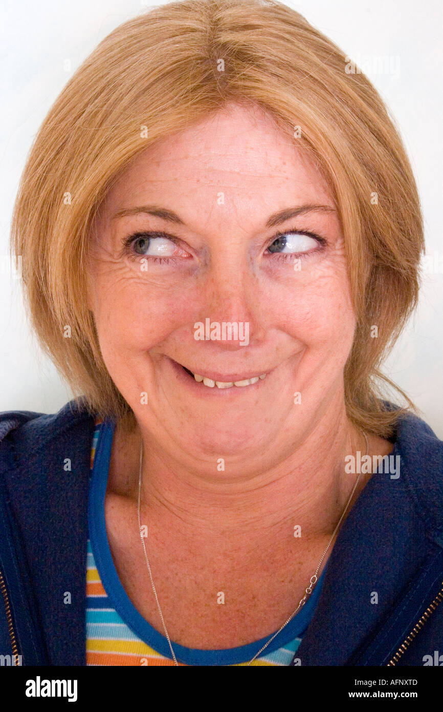 Blond middle aged Irish woman smiling and Grinning - Stock Image