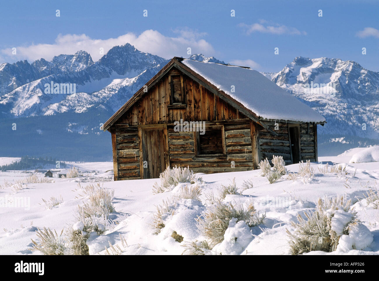 USA Stanley Idaho Winter Scene Of Rustic Trappers Log Cabin With Sawtooth Mountains In Background