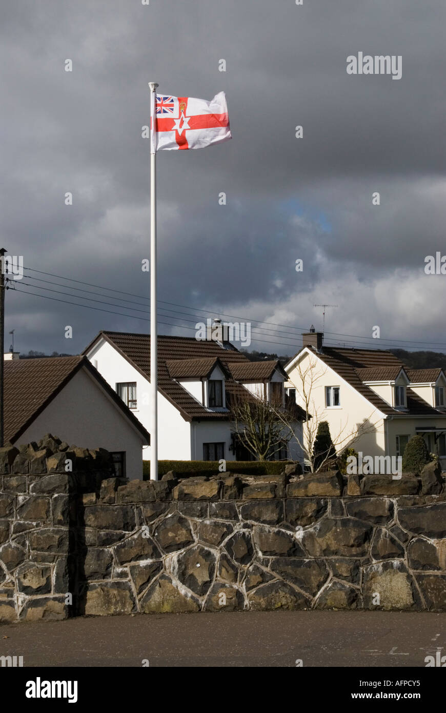 The loyalist Ulster Unionist flag flies over the village of Broughshane in Northern Ireland - Stock Image