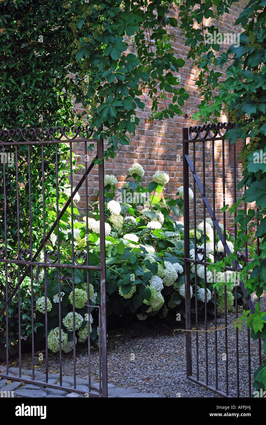 An Open Gate In A Country Farmhouse Garden In Italy Stock Photo Alamy