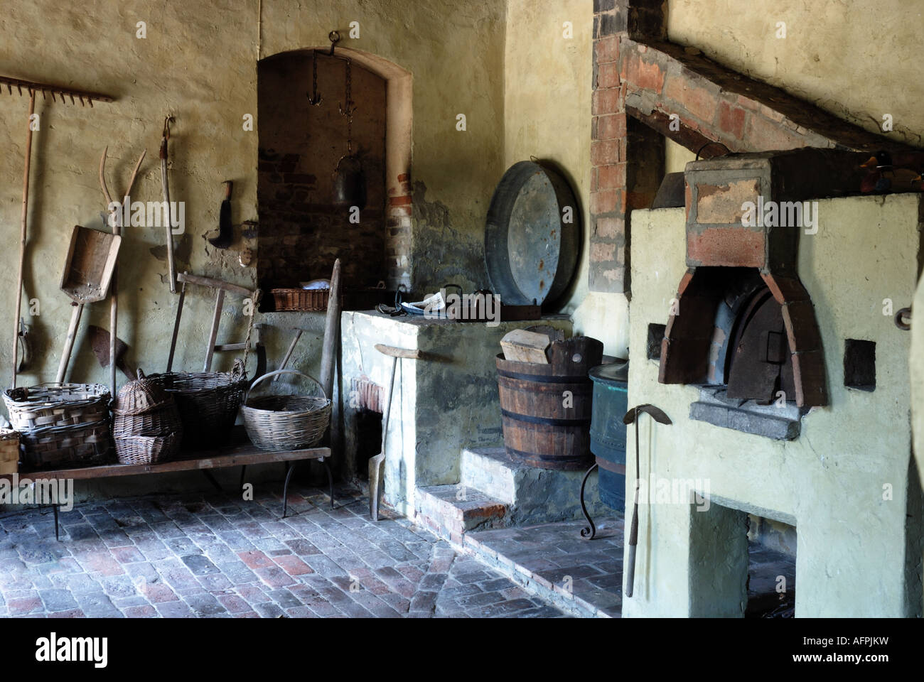 A Collection Of Old Fashioned Agricultural Tools In Farmhouse Kitchen Italy