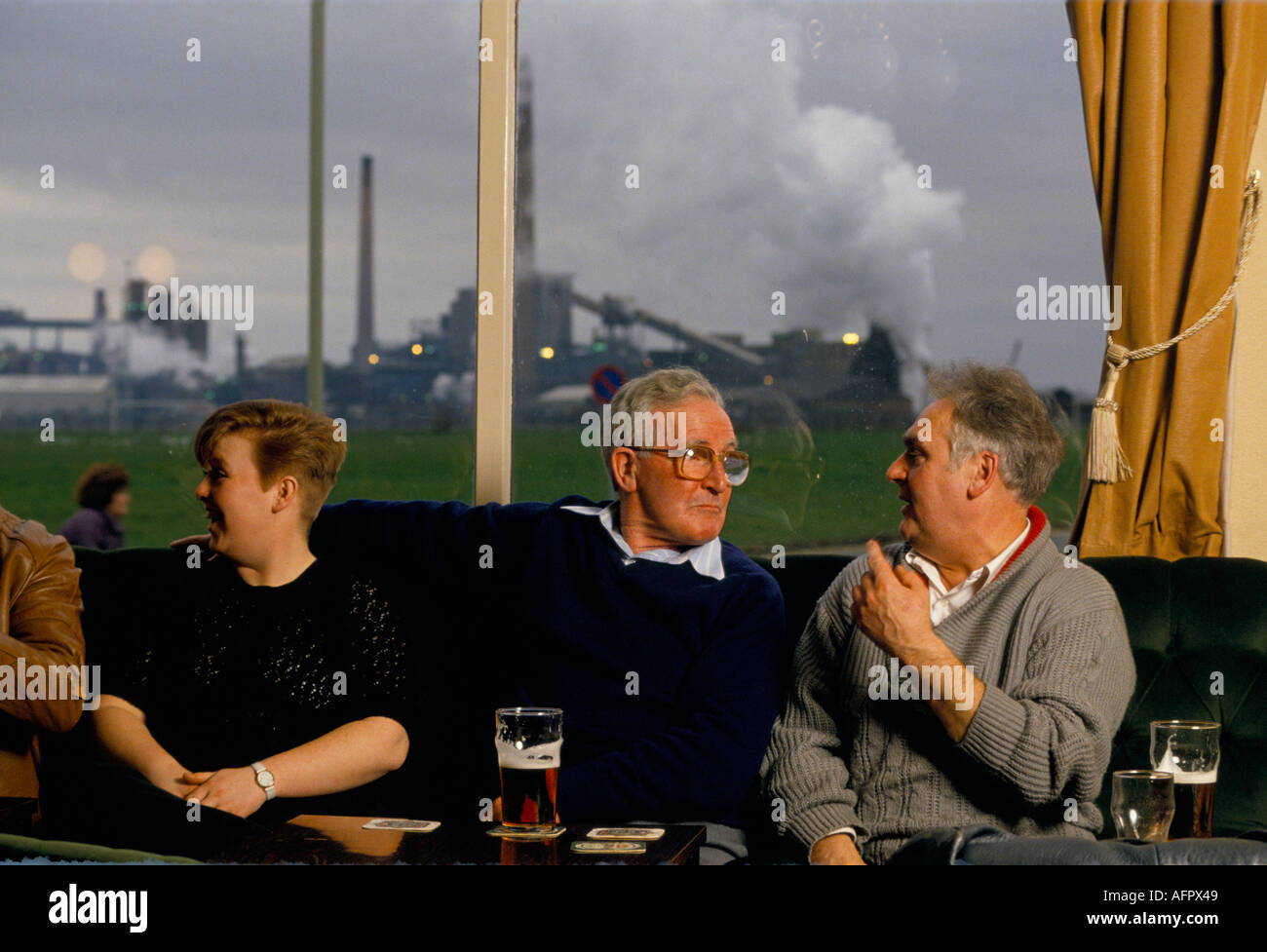 Industrial pollution. MONKTON COKING PLANT CLUB. Works club members  drink  and relax in the shaddow of the power plant.  1990s HOMER SYKES - Stock Image