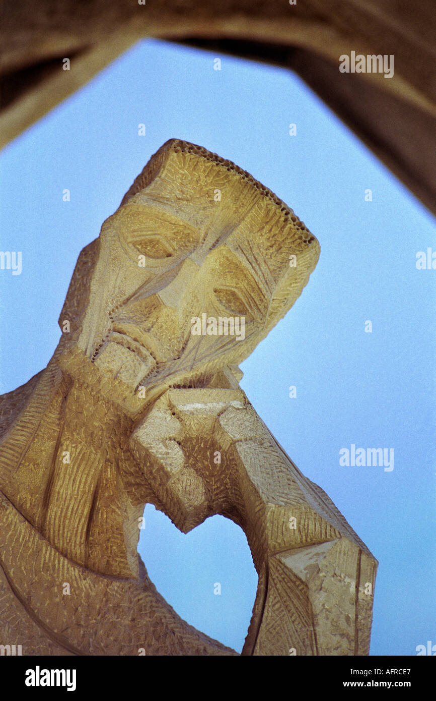 The thinker sculpture on the south western wall of La Sagrada Familia in Barcelona was designed by artist Josep Subirachs - Stock Image