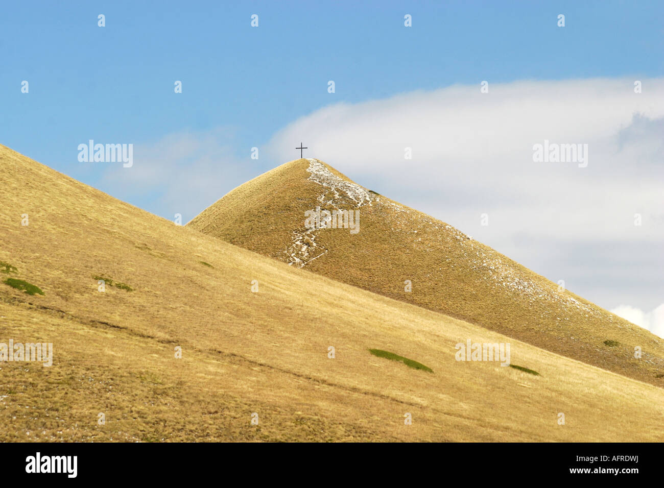 A Distant Cross tops Gloriously  coloured Sasso Tetto  mountain in the Sibillini National Park,Le Marche,The Marches, Stock Photo