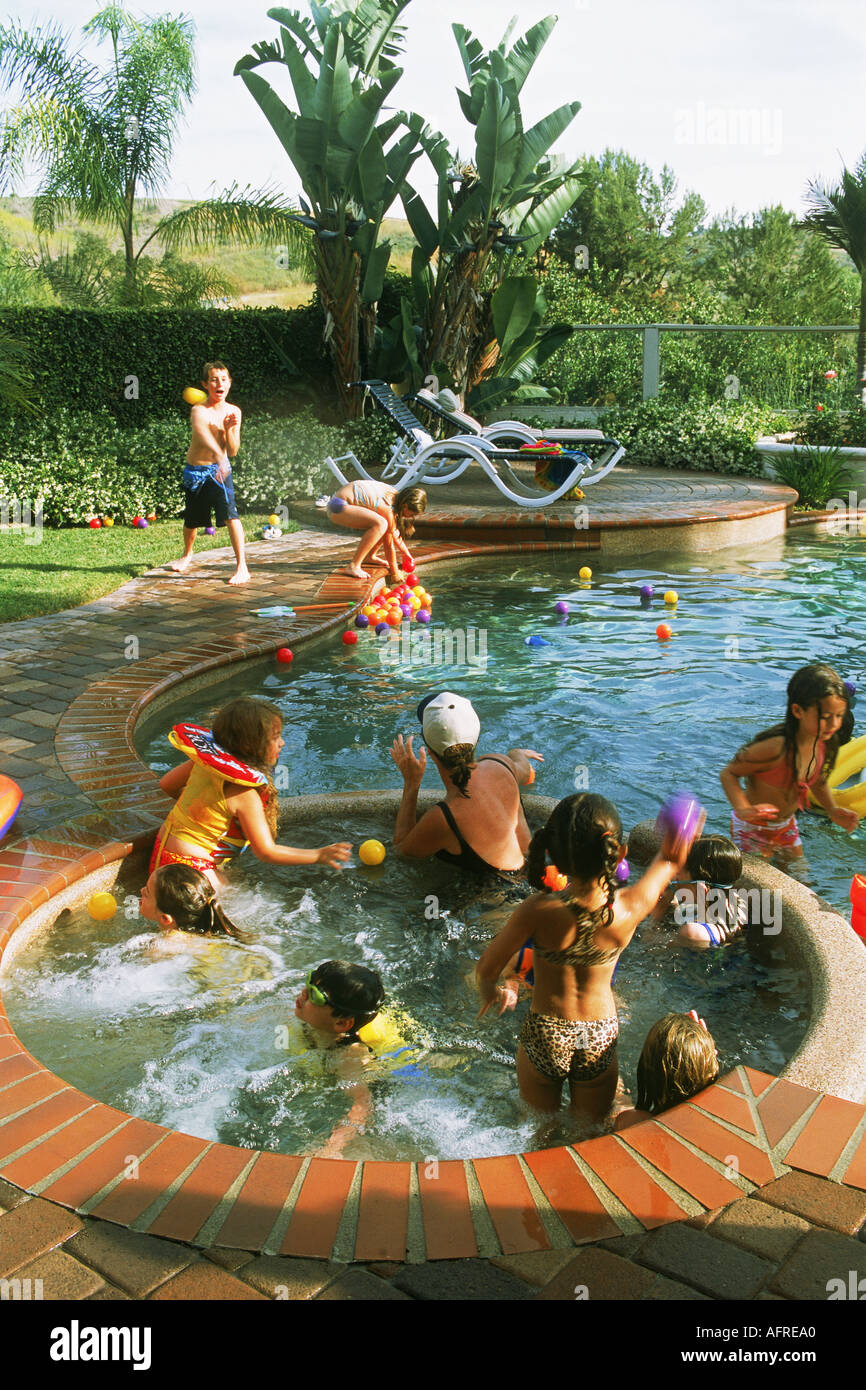 Kids Playing In Backyard Swimming Pool During Birthday Party Southern California Track Home