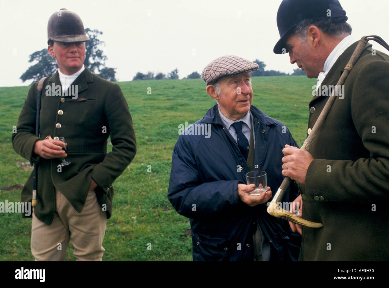 Ian Farquhar (right) with local farmer  hunt members with stirrup cup Duke of Beaufort Hunt Gloucestershire  UK. HOMER SYKES - Stock Image