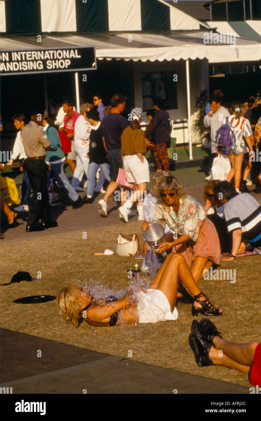 drunk girls behaving badly have been binge drinking Wimbledon tennis  HOMER SYKES - Stock Image