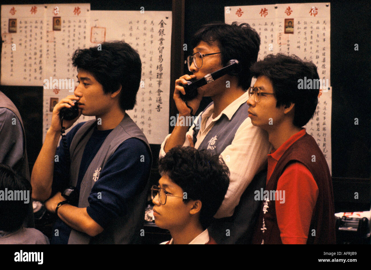 Dealers on the telephone. The Hong Kong Gold Exchange China PHOTO HOMER SYKES - Stock Image