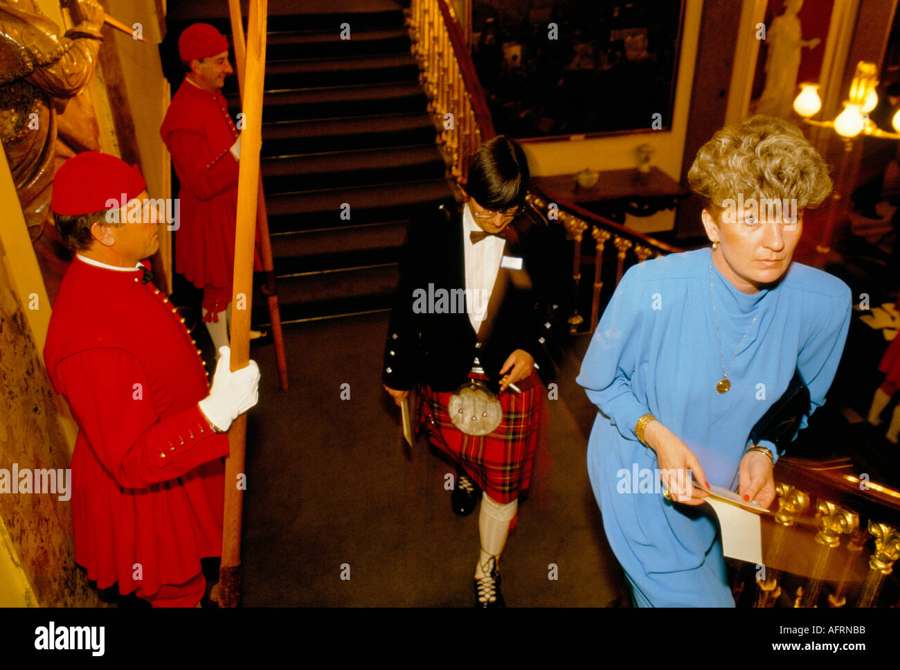 BANQUET AT 'FISHMONGERS HALL'  LONDON LIVERY COMPANY DOGGETTS MEN LINE STAIRS TO HALL PHOTO HOMER SYKES - Stock Image
