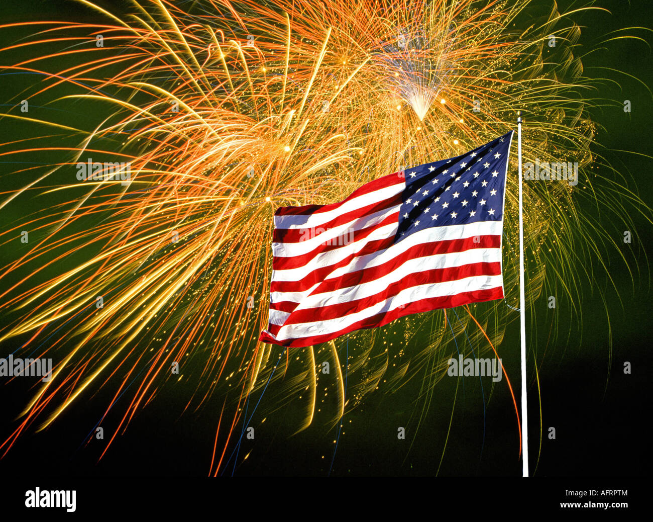 an american flag in front of a fireworks display on july the 4th the fourth of july