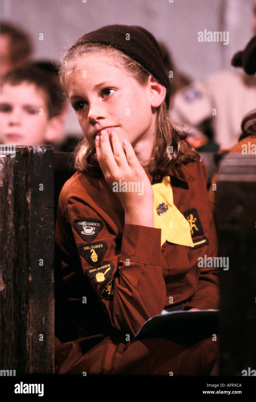 Young Brownie also know as junior Girl Guides in uniform badges UK HOMER SYKES - Stock Image