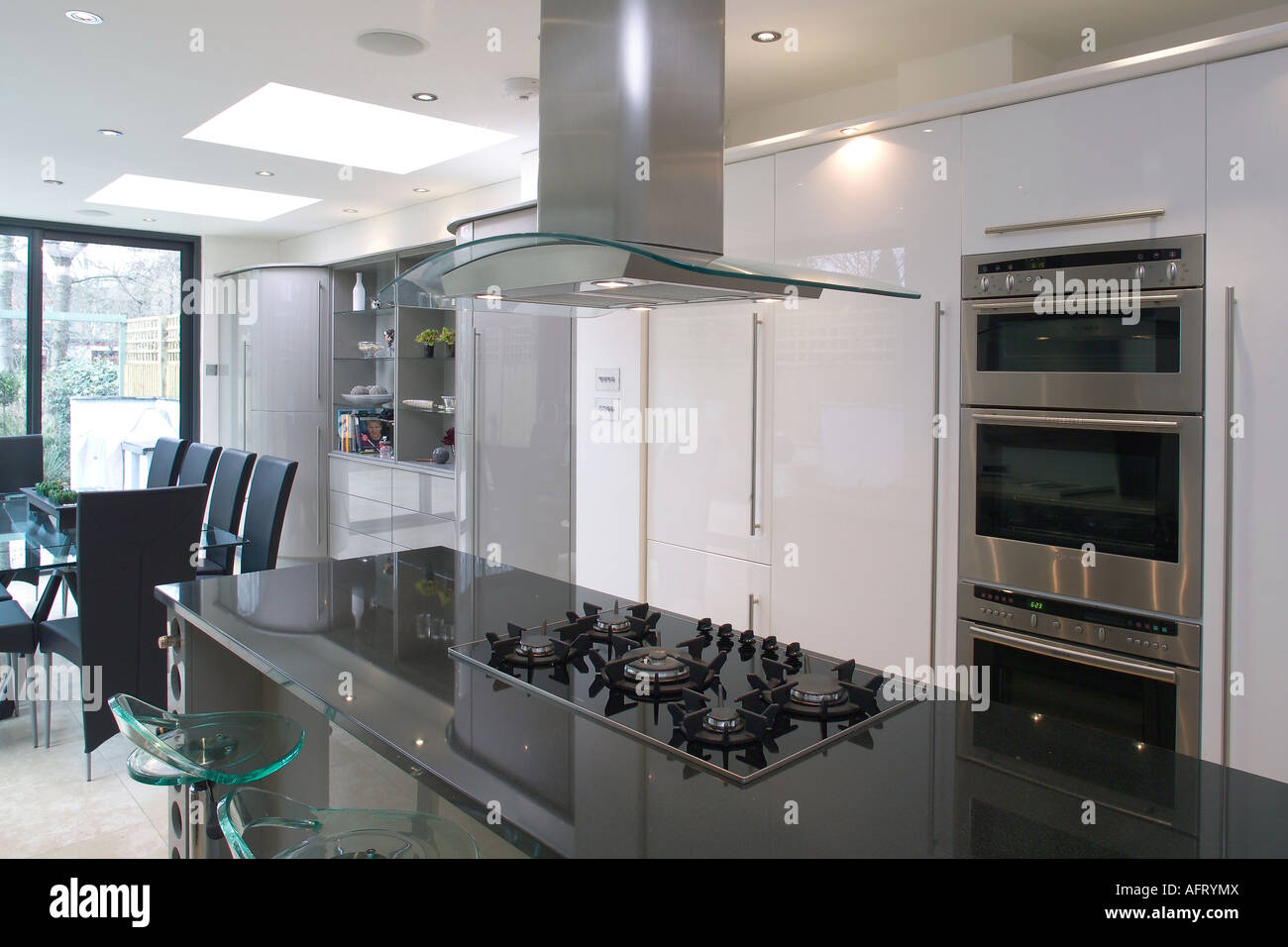 Kitchen Island Extractor Fans Extractor fan above hob in black granite island unit in modern stock extractor fan above hob in black granite island unit in modern openplan kitchen with wall mounted oven workwithnaturefo