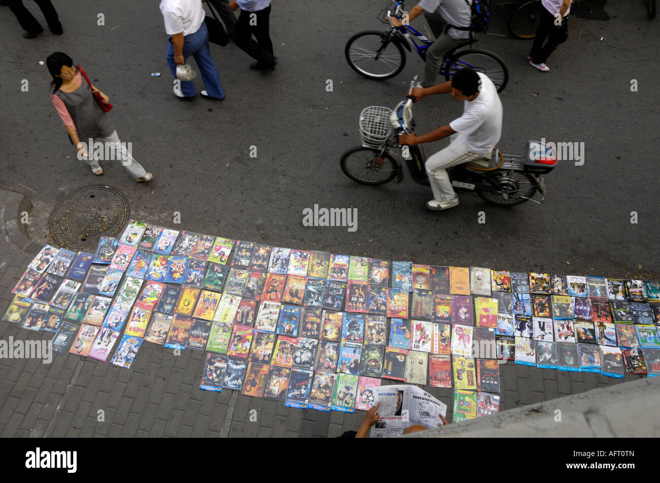 Vendors sell fake DVDs on the streets in Beijing, China. 11-Sep-2007 - Stock Image